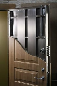 black steel door with wooden cover